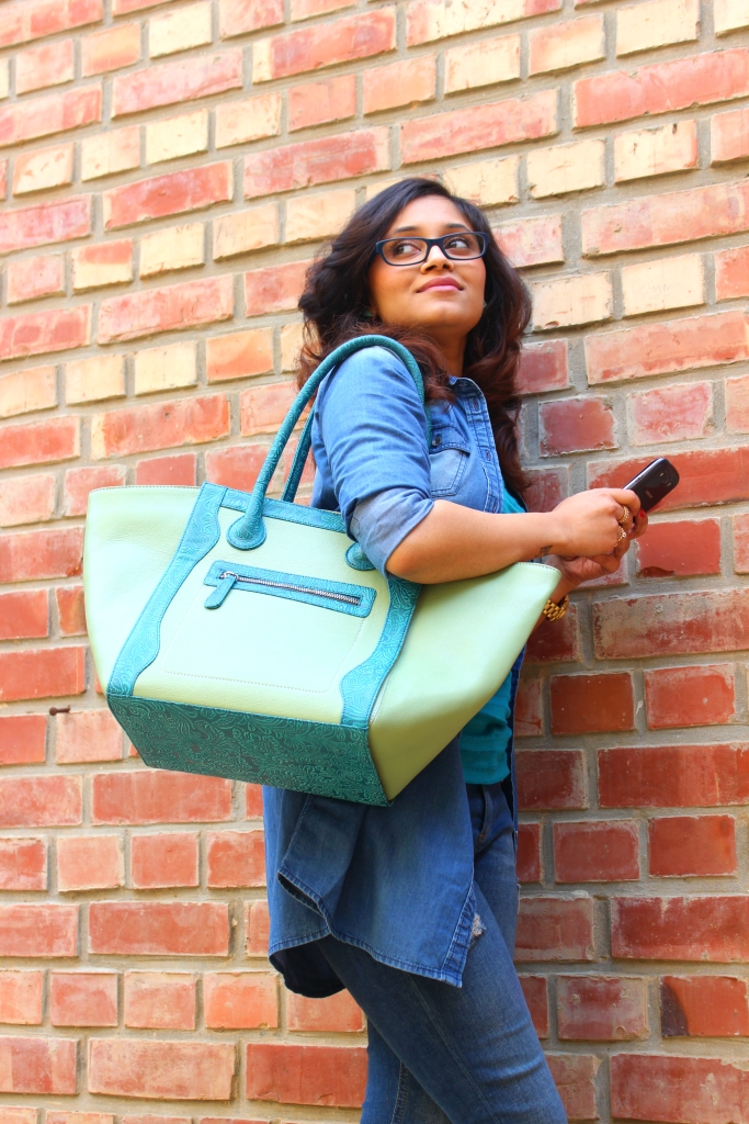 Featuring Olive Green Cow Leather Tote with detachable textured leather handles. Price: 5500 INR